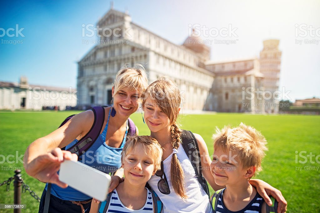 Mother and kids tourists taking selfie in Pisa stock photo