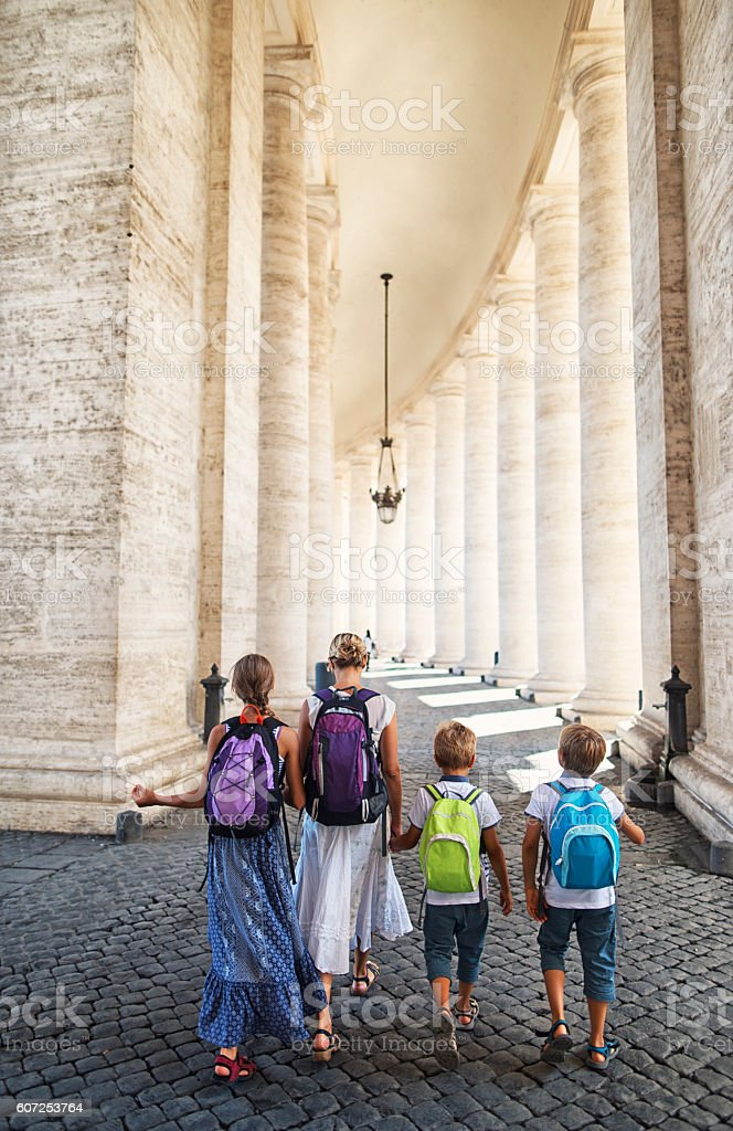 Mother and kids visiting Rome and Vatican stock photo