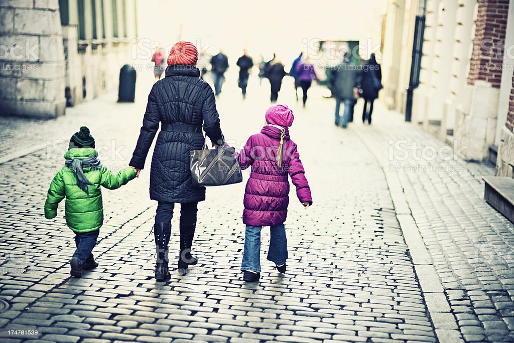 Mother and kids walking royalty-free stock photo