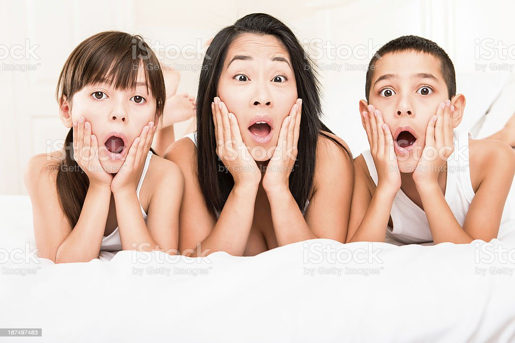 Mother and kids with a shocked look royalty-free stock photo
