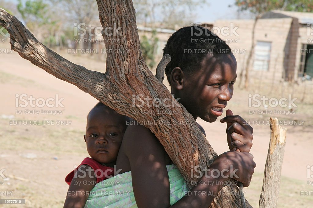 Mother and little child in village Sigagule, South Africa royalty-free stock photo