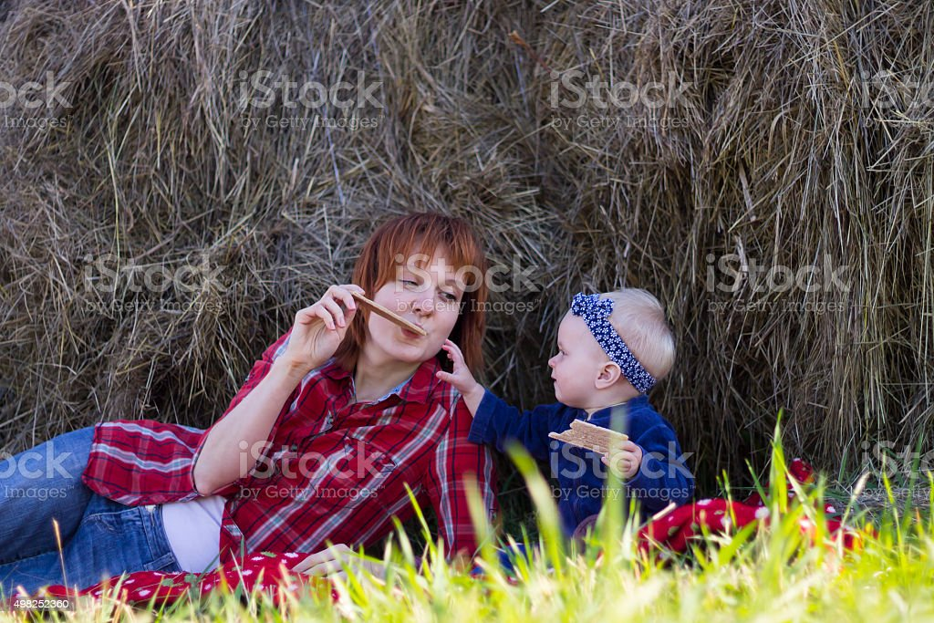 Mother and Little Daughter Eating Crisp Bread Outdoor stock photo