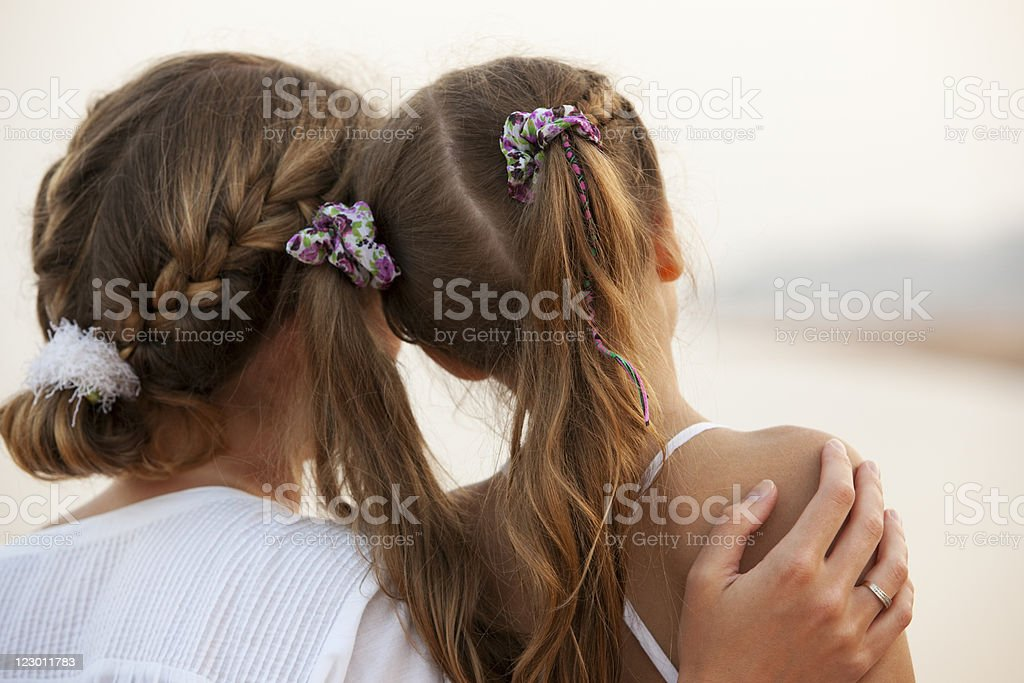 Mother and little daughter enjoying view on beach royalty-free stock photo