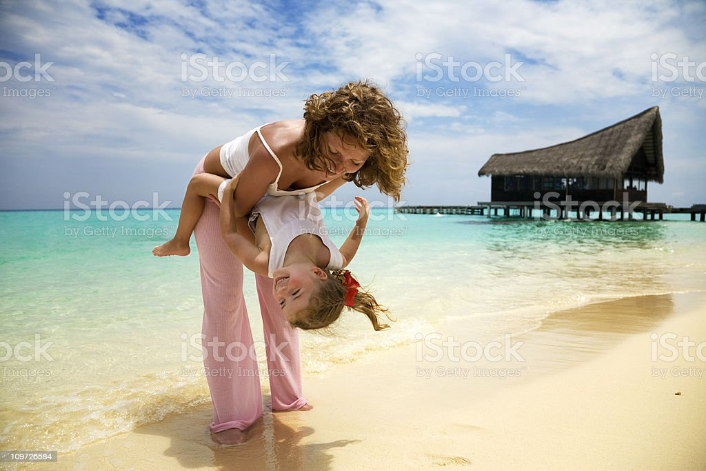 Mother and Little Daughter Having Fun on Tropical Beach royalty-free stock photo