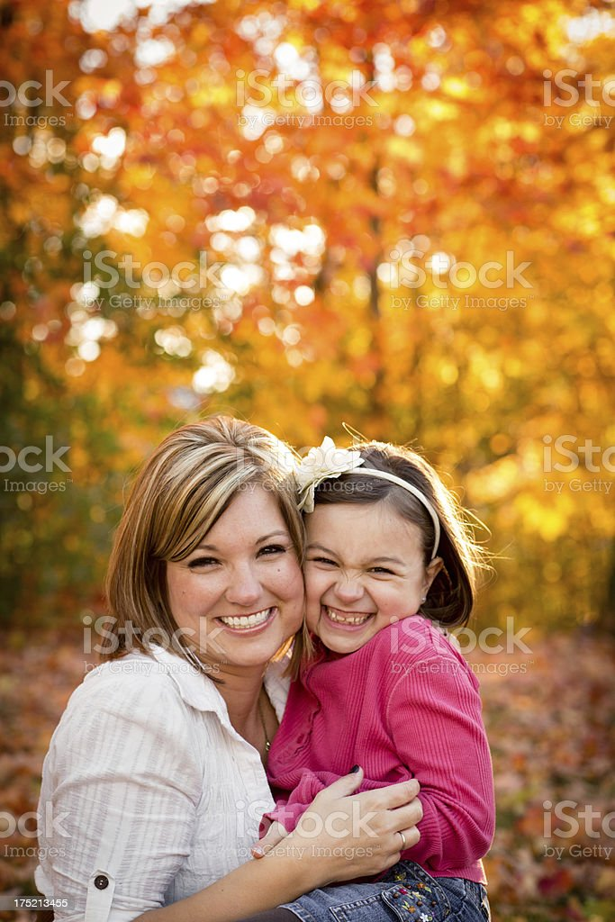Mother and Little Daughter Hugging, With Scenic Fall Background royalty-free stock photo