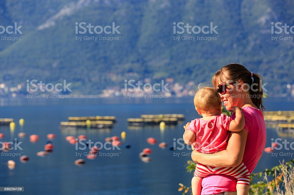 mother and little daughter in the bay of Montenergo stock photo