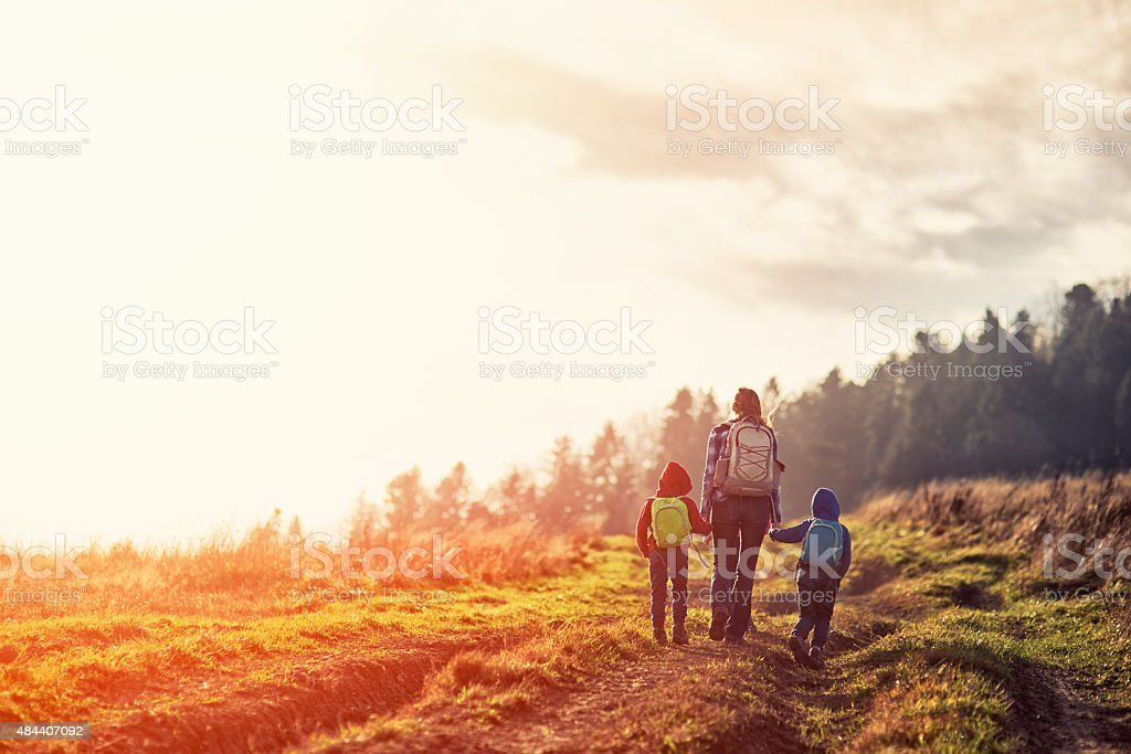 Mother and little kids hiking in moutains stock photo