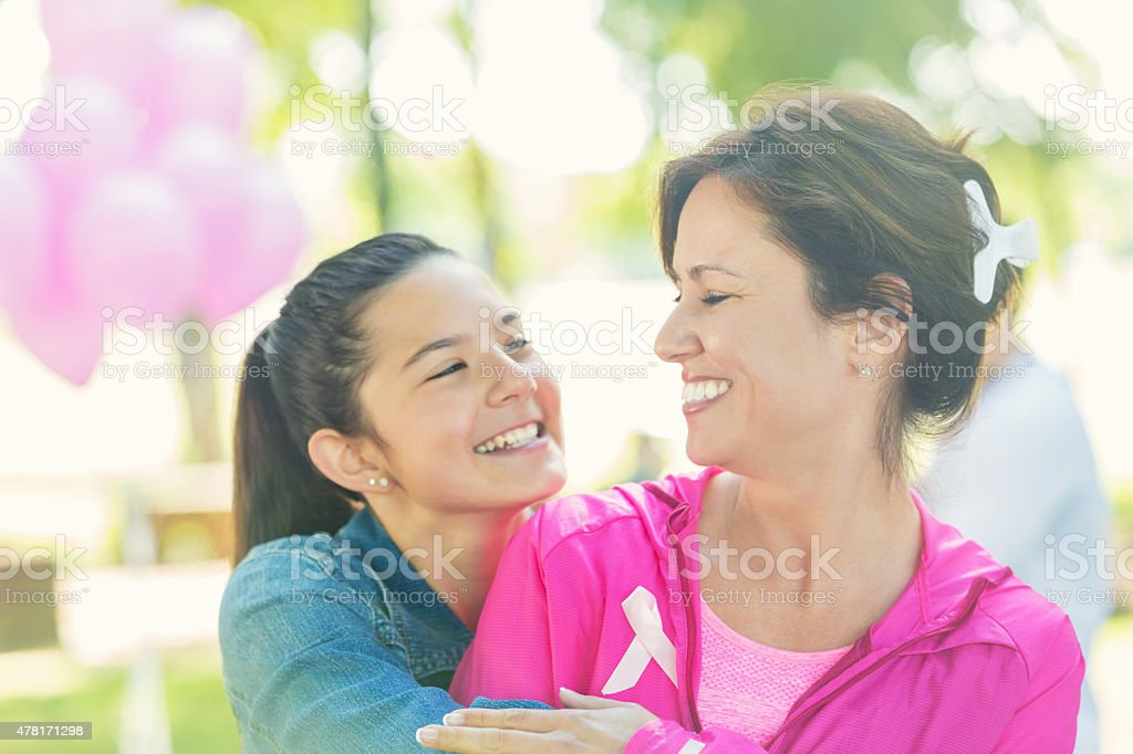 Mother and preteen daughter at breast cancer awareness charity race stock photo