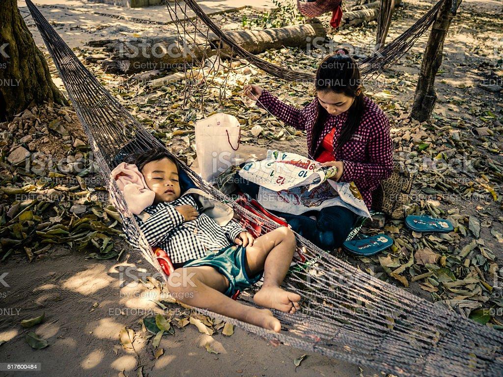 Mother and sleeping child Wat Bo Pagoda Cambodia stock photo