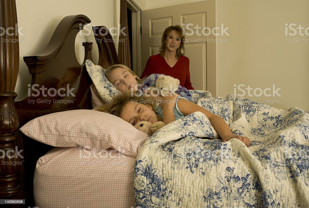 Mother and sleeping children stock photo
