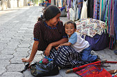 Mother and small child in Santa Catarina Poropo,  Guatemala