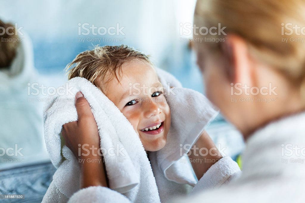 Mother and son after bath royalty-free stock photo