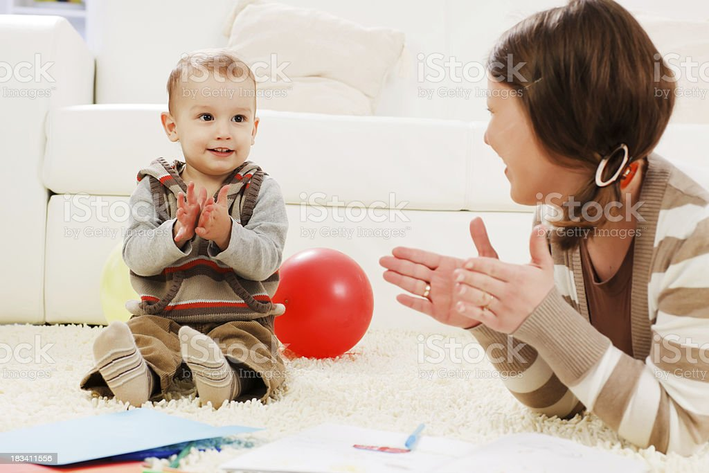 Mother and son are playing at home. royalty-free stock photo