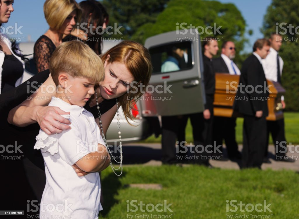 Mother and Son at a Funeral stock photo
