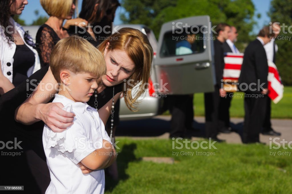 Mother and Son at a Funeral royalty-free stock photo