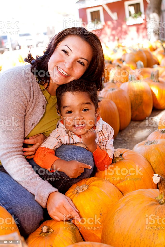 Mother and Son at a Pumpkin Patch royalty-free stock photo