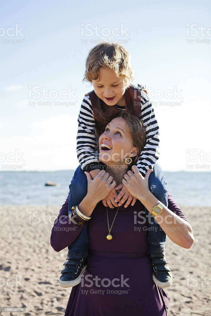Mother and son at beach. royalty-free stock photo