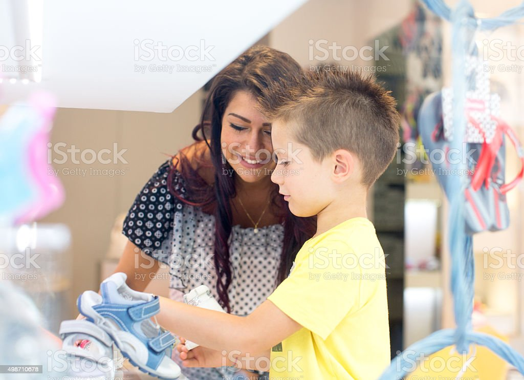 Mother and son at children's store stock photo