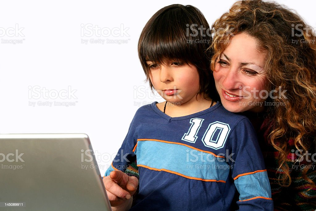 Mother and son at computer royalty-free stock photo