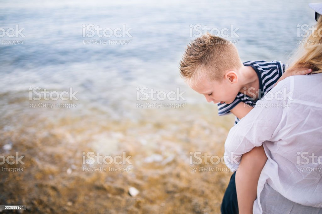 Mother and son by the sea stock photo
