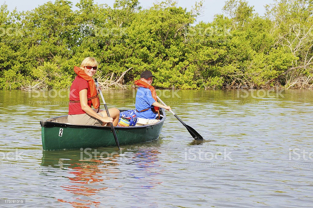 Mother and Son Canoeing in a Sanibel Island Bayou royalty-free stock photo