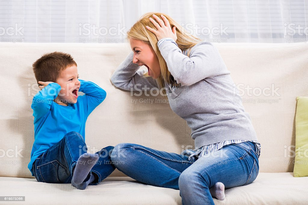 Mother and son conflict stock photo