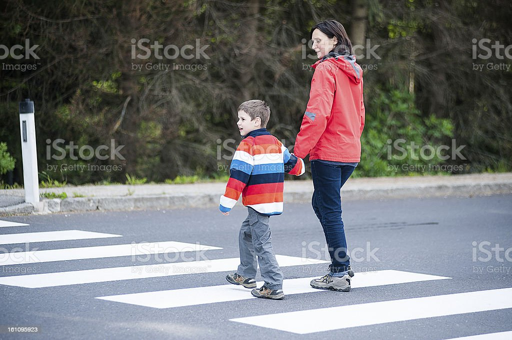 Mother and Son crossing the Street stock photo