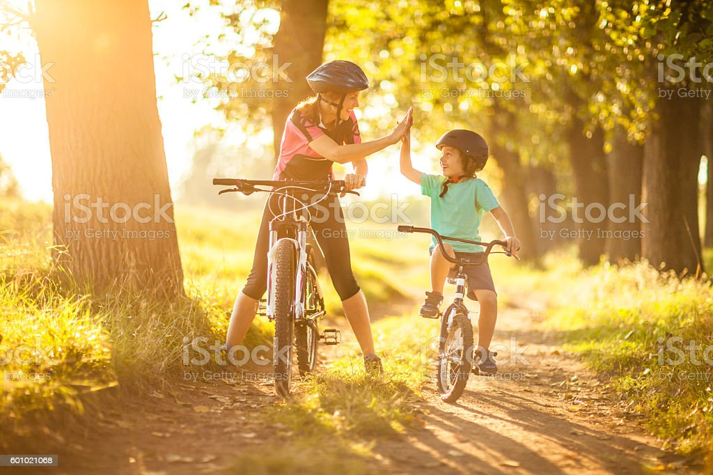 Mother and son cycling in the countryside stock photo