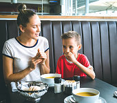 Mother and son dine in the restaurant