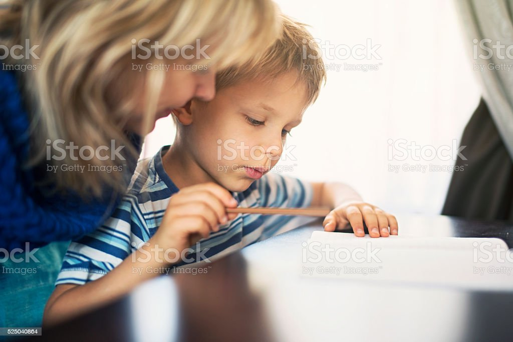 Mother and son doing homework stock photo