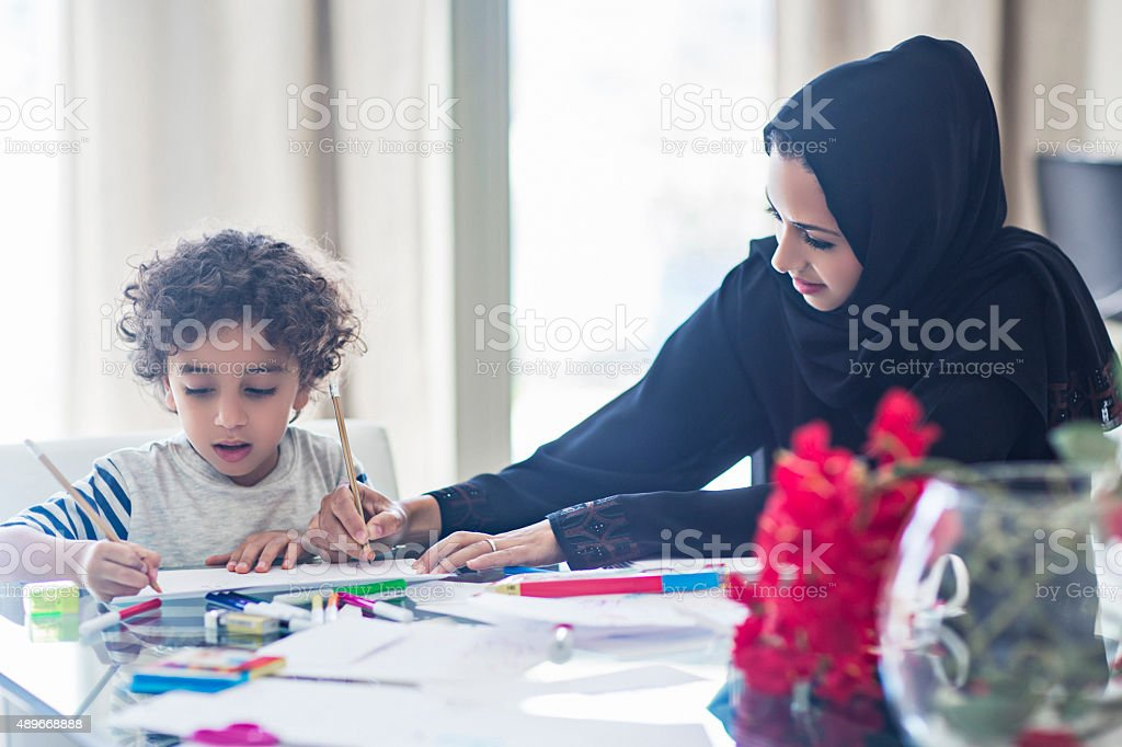 Mother and son drawing at home stock photo