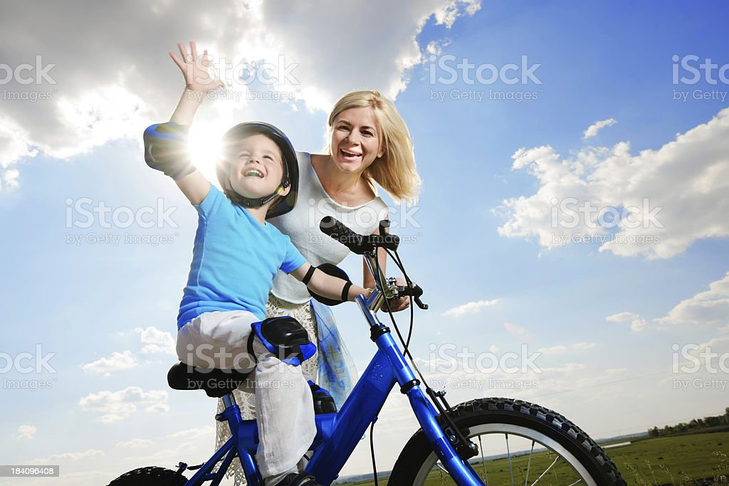 Mother and son enjoying in a beautiful day outdoors. royalty-free stock photo