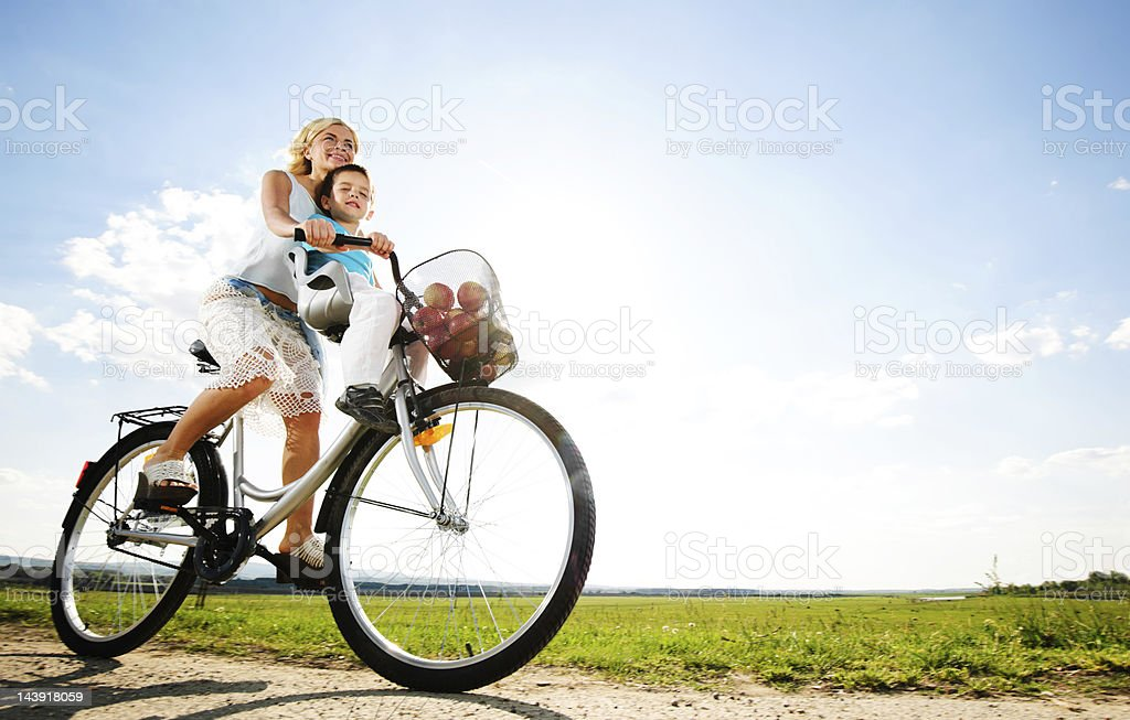 Mother and son enjoying in a bicycle ride. stock photo