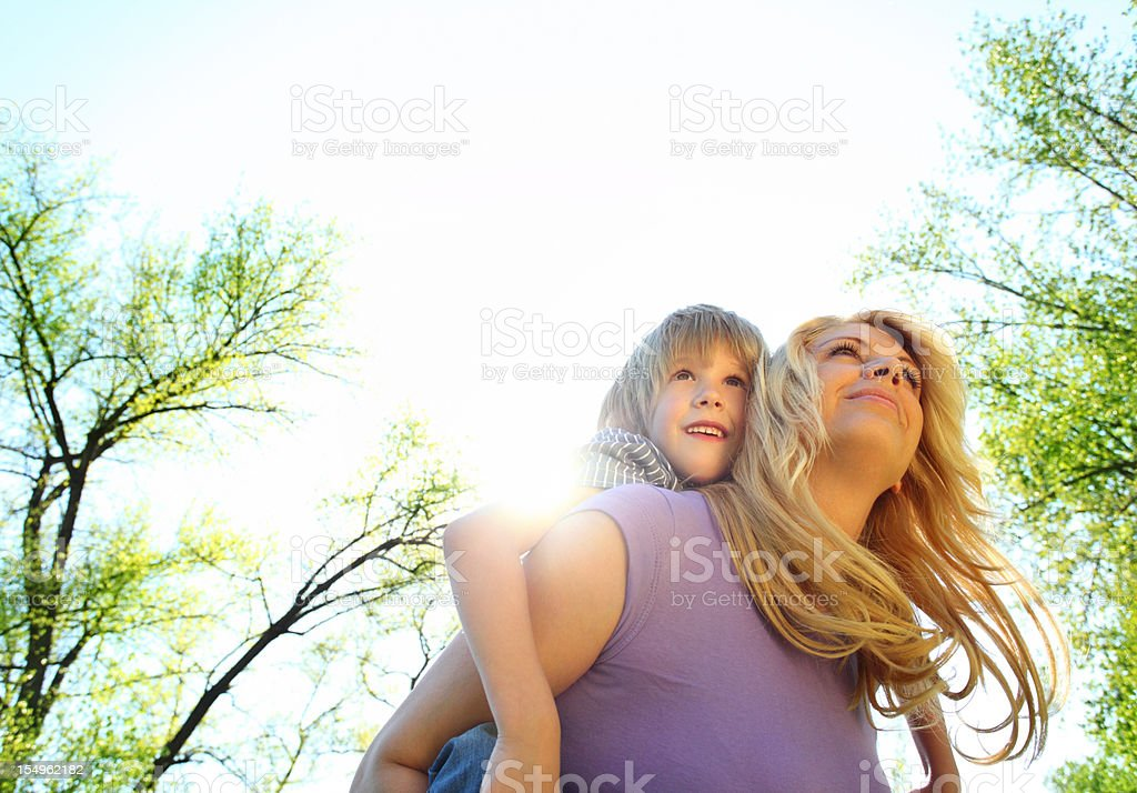 Mother and son enjoying outdoors. royalty-free stock photo