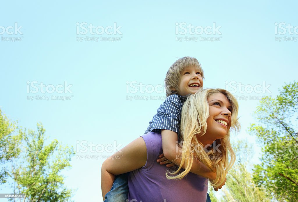 Mother and son enjoying outdoors. stock photo