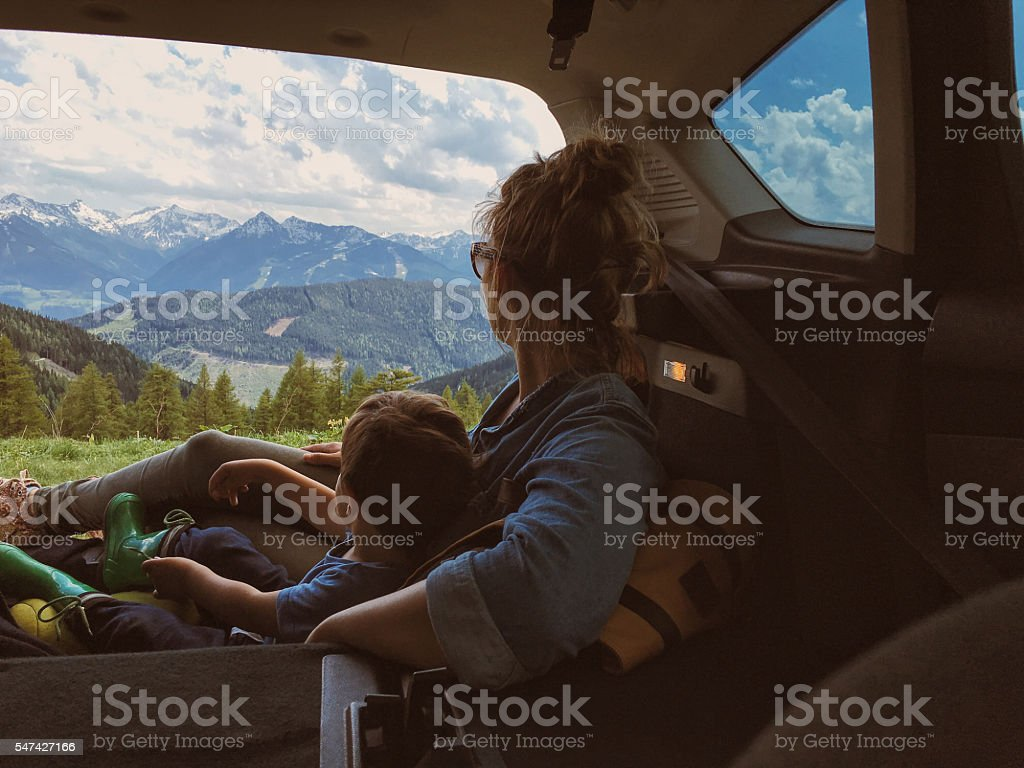 Mother and son enjoying the view of mountains stock photo
