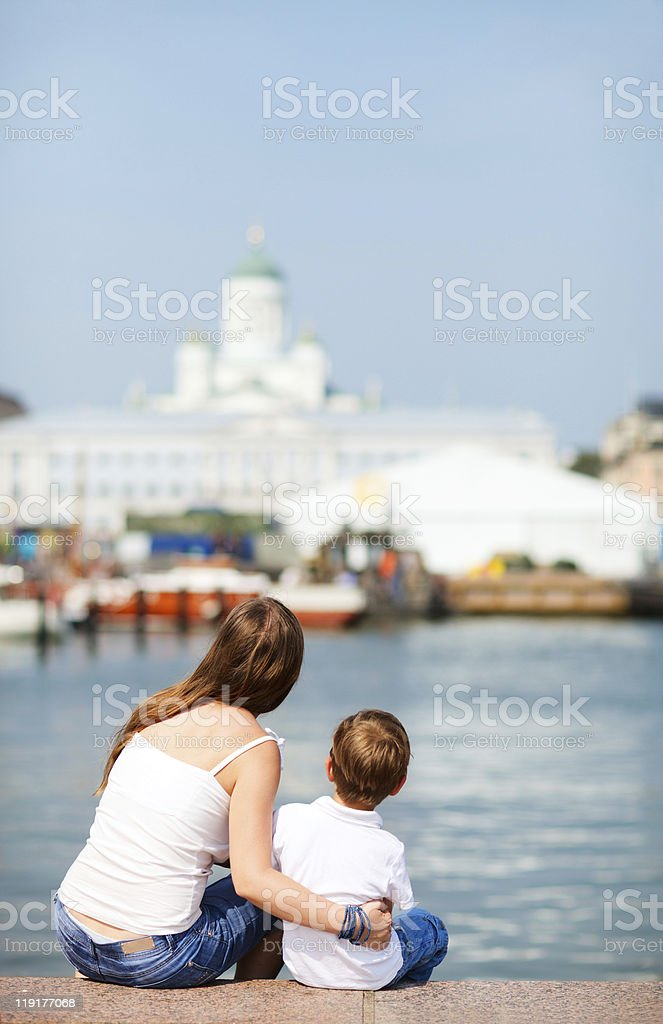 Mother and son enjoying views of city center royalty-free stock photo
