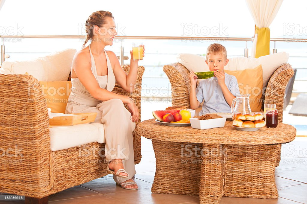 Mother and son having a breakfast royalty-free stock photo