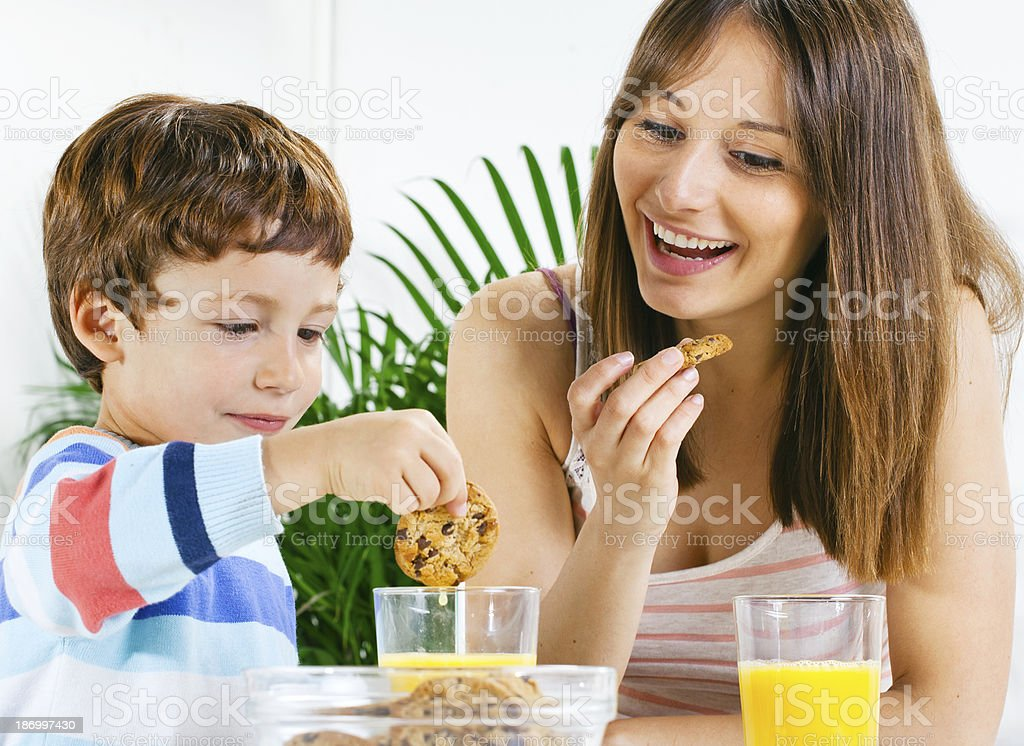 Mother and son having breakfast. royalty-free stock photo