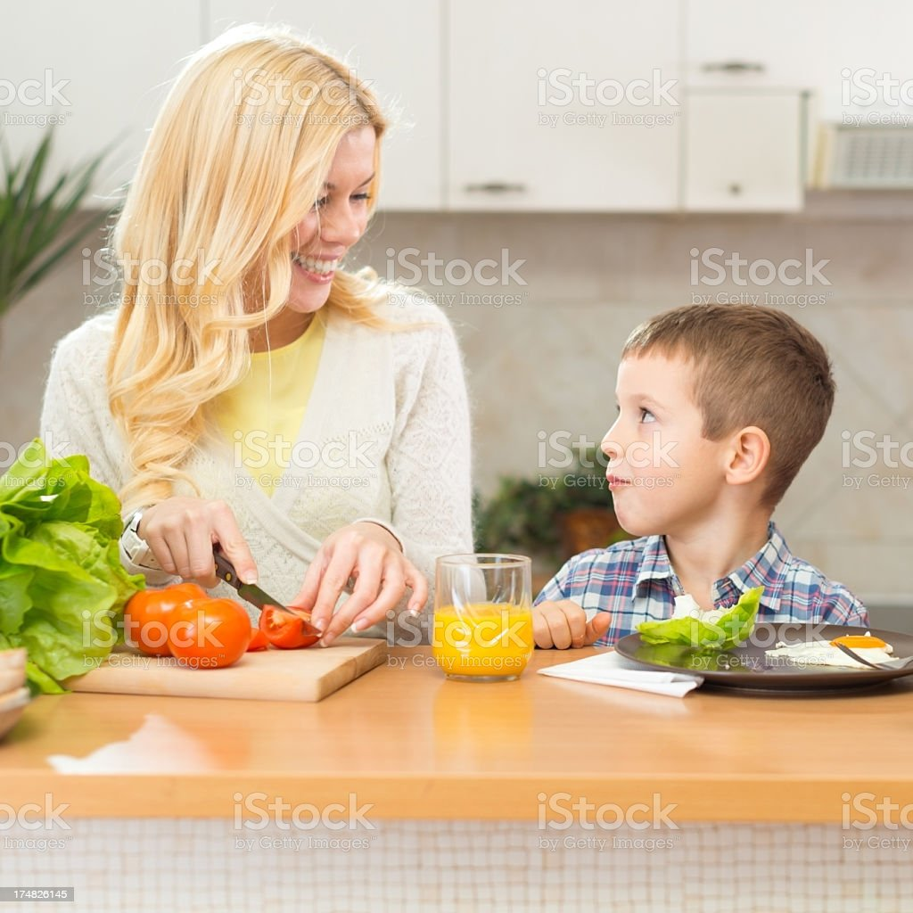 Mother and son having breakfast together in the kitchen royalty-free stock photo