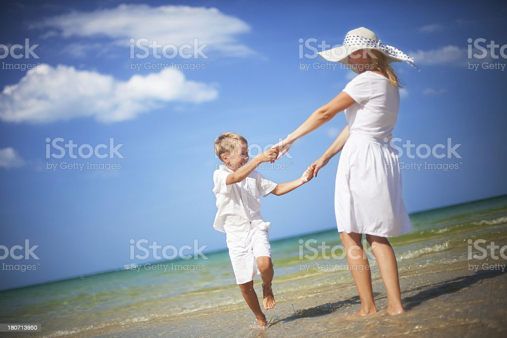 Mother and son having fun on a beach royalty-free stock photo
