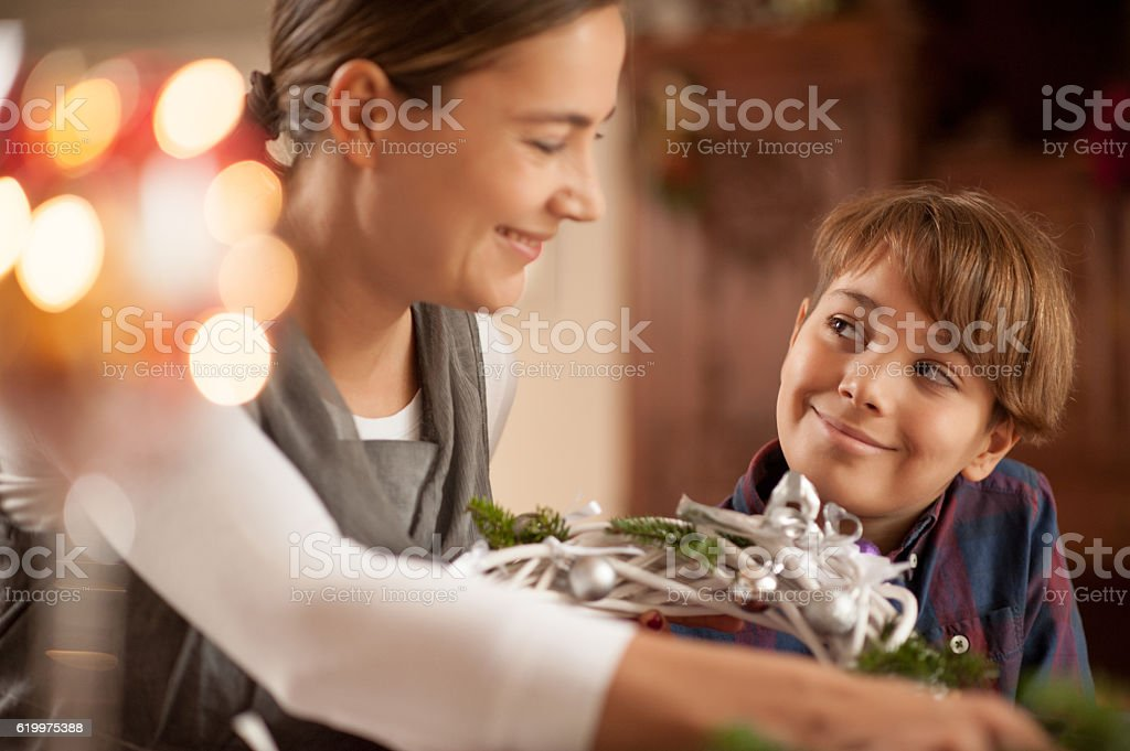 Mother and Son having Fun Preparing the Christmas Wreath stock photo