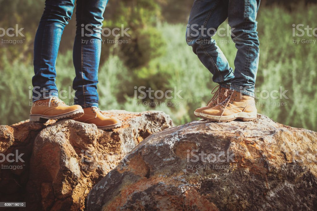 mother and son hiking boots in mountains stock photo