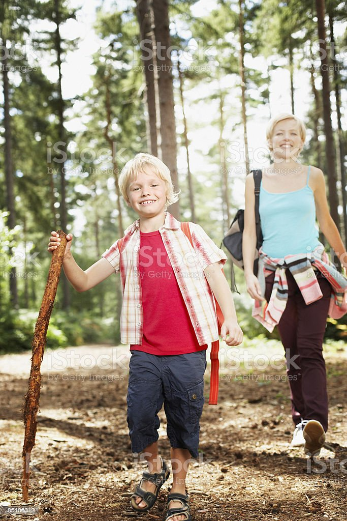 Mother and son hiking in woods royalty-free stock photo