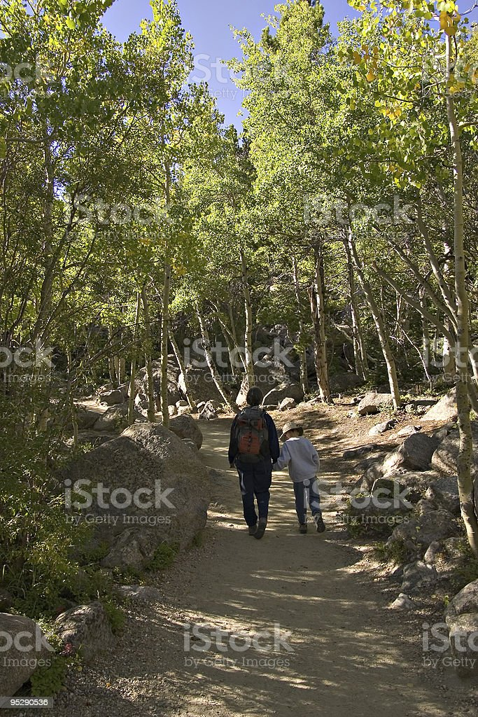 Mother and Son Hiking On A Wooded Mountain Trail stock photo