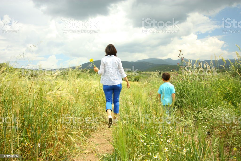 Mother and son hiking royalty-free stock photo