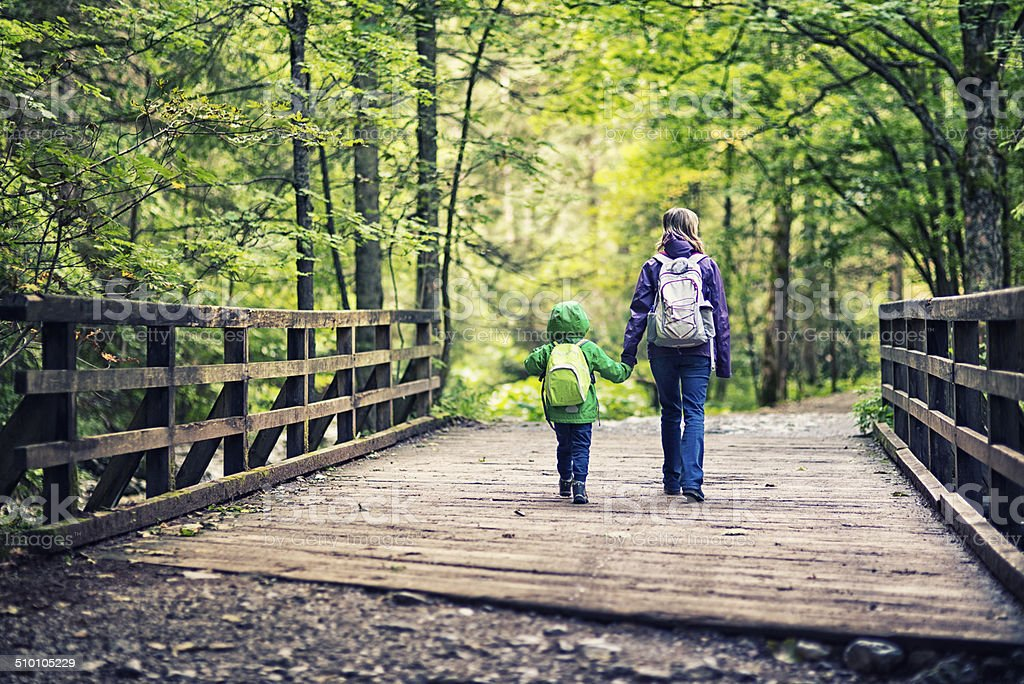 Mother and son hiking stock photo