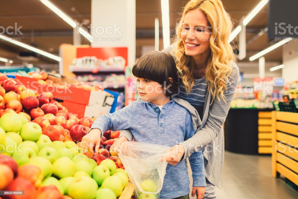 Mother and Son In A Supermarket stock photo