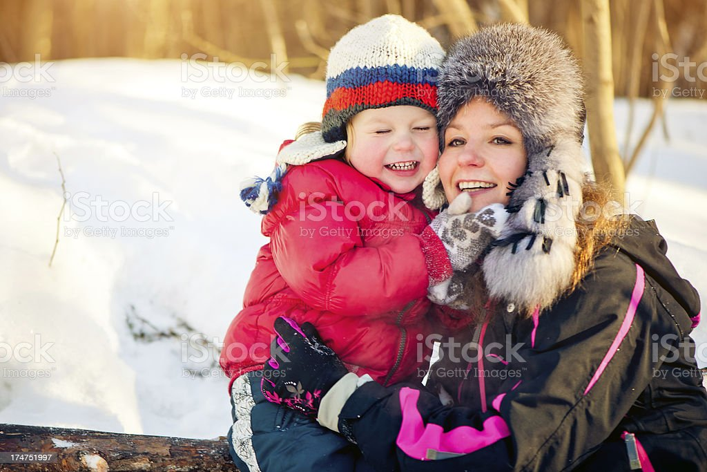 Mother and son in a winter park royalty-free stock photo