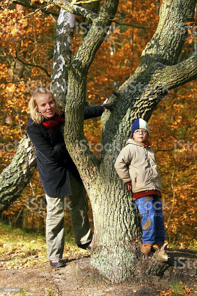 Mother and son in an autumn wood royalty-free stock photo